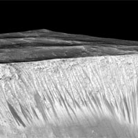 <p>Mars' Valles Marineris canyon, pictured, spans as much as 600 kilometers across and delves as much as 8 kilometers deep. The image was created from over 100 images of Mars taken by Viking Orbiters in the 1970s.</p>