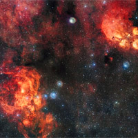 <p>This spectacular image from the VLT Survey Telescope shows the Cat's Paw Nebula (NGC 6334, upper right) and the Lobster Nebula (NGC 6357, lower left). These dramatic objects are regions of active star formation where the hot young stars are causing the surrounding hydrogen gas to glow red. The very rich field of view also includes dark clouds of dust. With around two billion pixels this is one of the largest images ever released by ESO. A zoomable version of this giant image is available here.</p>