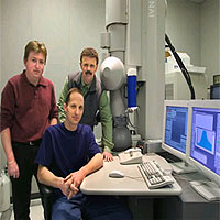 From left, Berkeley Lab scientists Nigel Browning, Alexander Ziegler (seated) and Robert Ritchie used this Scanning Transmission Electron Microscope to find new ways to toughen up advanced ceramics.