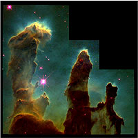 The Eagle Nebula, as photographed by the Hubble Space Telescope. This famous photo, often known as 'The Pillars of Creation,' shows giant nebular clouds being evaporated by the ferocious energy of massive stars, exposing emerging solar systems, much like our own.