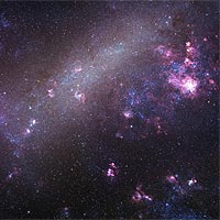 Astronomers have measured the 3-D velocities of the Large Magellanic Cloud (shown here) and the Small Magellanic Cloud. They found surprisingly high speeds, which may indicate that the Milky Way is twice as massive as previously thought, or that the Magellanic Clouds are not gravitationally bound to the Milky Way but instead are 'just passing through.' <br /><br />(Copyright Robert Gendler and Josch Hambsch 2005)<br />