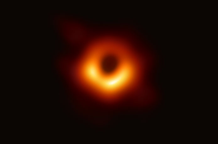 <p>The image shows a bright ring formed as light bends in the intense gravity around a black hole that is 6.5 billion times more massive than the Sun. Credit: Event Horizon Telescope Collaboration</p>
