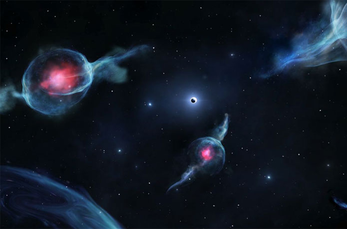 <p>Artist's impression of G objects, with the reddish centers, orbiting the supermassive black hole at the center of our