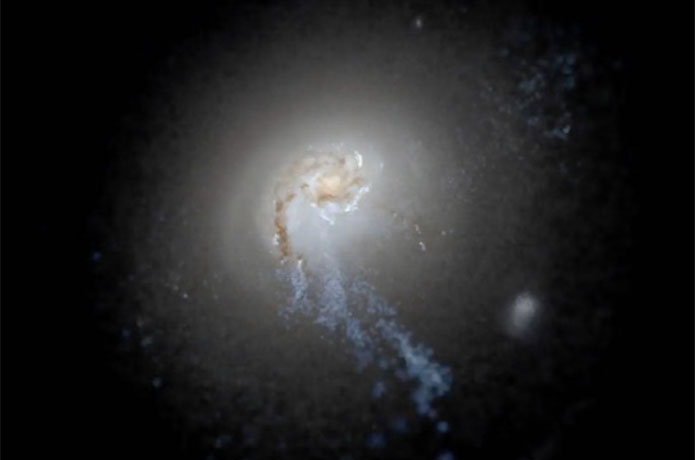 <p>A simulated galaxy image from the FIRE-2 project, representing a structure spanning more than 200,000 light years, sh