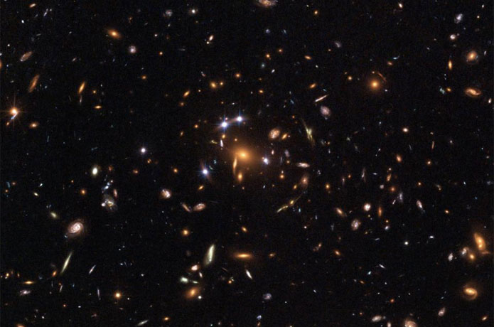 <p>This image from the Hubble Space Telescope shows lensing of distant galaxies by gravity. UC Davis astronomers are usi